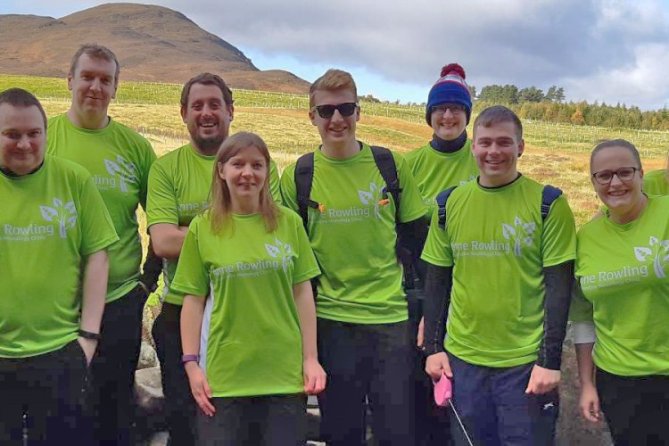 Group of fundraisers in Anne Rowling T-shirts with hills in background