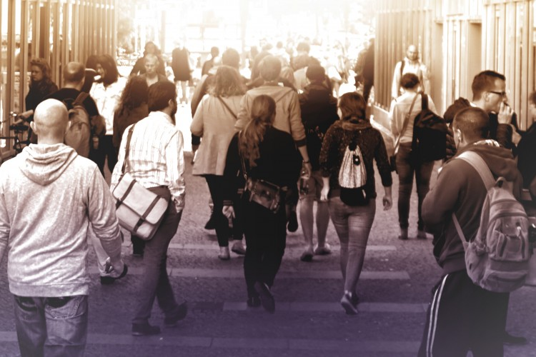 crowd scene of people walking down a street